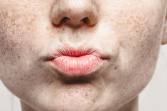 Lips kiss woman Young beautiful freckles woman face portrait with healthy skin Stock Photography