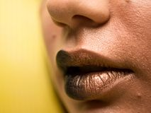 Lips make-up. Beauty high fashion trendy black with gold colour gradient lips makeup sample, mouth closeup. stock images