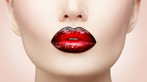 Lips makeup. Beauty high fashion gradient lips makeup sample, black with red color. mouth closeup. Lipstick royalty free stock image