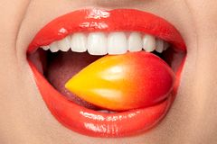 Lips Makeup. Lips With Colored Lipstick And Sweets. Stock Photography