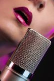 Lips and microphone closeup Royalty Free Stock Image