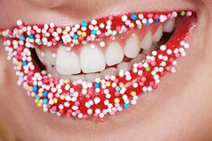 Lips with multicolored pearls sugar Stock Photography