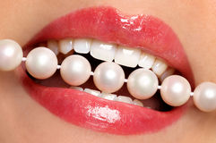Lips and pearls. Teeth, pearls and red lips Stock Image