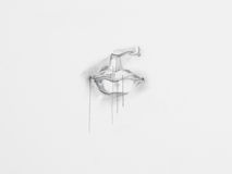 Lips pencil drawing. Detail of lips pencil drawing on white paper stock photography