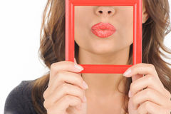 Lips in picture frame. Stock Photography