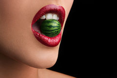 Lips. Red lips photoshop watermelon in the teeth Royalty Free Stock Photos
