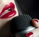 Lips singing music in microphone. Woman red lips singing music in microphone Stock Photos