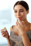 Lips Skin Care. Woman With Beauty Face Applying Lip Balm On. Lips Skin Care. Beautiful Woman With Beauty Face Applying Lip Balsam, Lipbalm On Full Sexy Lips Stock Images