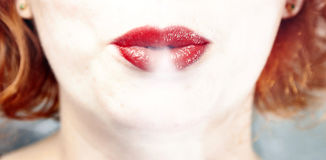 Lips and smoke Royalty Free Stock Images