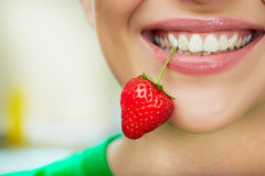 Lips with strawberry. Stock Photos