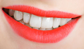 Lips and teeth. Beautiful lips and teeth of a young woman. Shallow DOF Stock Photography