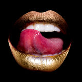 Lips with tongue on black Stock Image