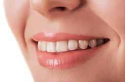Lips and tooth closeup of beautiful young woman isolated on whit Stock Photos