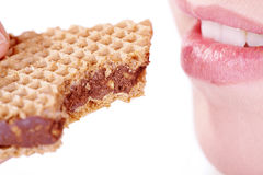 Lips woman eating a sweet chocolate snack Stock Image
