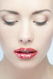 Lips of young blonde woman with vogue shining Royalty Free Stock Images