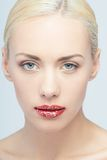 Lips of young blonde woman with vogue shining Stock Photo