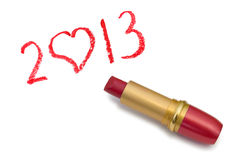 Lipstick and 2013. Isolated on white background royalty free stock photography