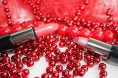 Lipstick. It is decorated by a red beads Stock Image