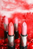 Lipstick. It is decorated by a red beads Royalty Free Stock Images