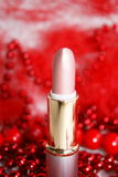 Lipstick. It is decorated by a red beads Royalty Free Stock Photography