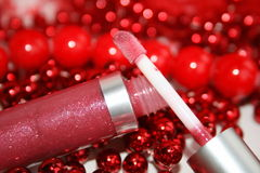Lipstick. It is decorated by a red beads stock photo