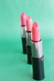 Lipstick. On a green background Royalty Free Stock Photos