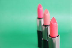 Lipstick. On a green background Stock Photos