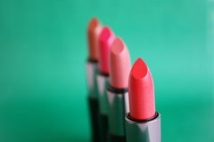 Lipstick. On a green background Royalty Free Stock Images