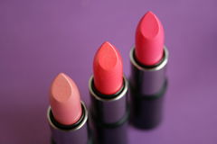Lipstick. On a lilac background stock images