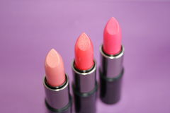 Lipstick. On a  lilac background Royalty Free Stock Images