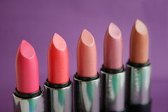 Lipstick. On a  lilac background Stock Photos