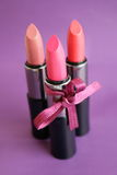 Lipstick. On a lilac background royalty free stock image