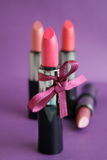 Lipstick. On a  lilac background Stock Photography