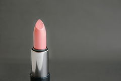 Lipstick. On a   black  background Royalty Free Stock Image