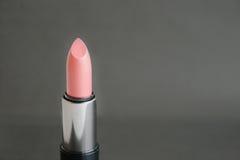 Lipstick. On a   black  background royalty free stock image