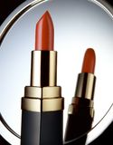 Lipstick. Tube in front of mirror Royalty Free Stock Images