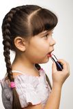 Lipstick. Photo of a girl with lipstick, playing adult Royalty Free Stock Photos