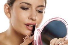 Lipstick applying Royalty Free Stock Photography
