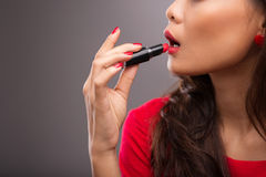 Lipstick applying Royalty Free Stock Photos