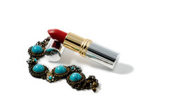 Lipstick and bracelet. On white background Stock Image