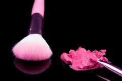 Lipstick with a brush make-up on black Royalty Free Stock Photo