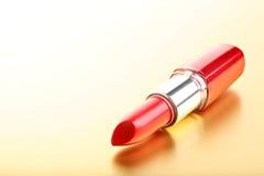 Lipstick closeup golden background Stock Photography