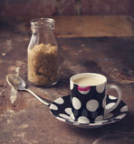Lipstick on coffee cup in rustic cafe or studio setting. Lipstick on coffee cup in rustic cafe or art studio setting royalty free stock photo