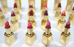 Lipstick color samples. A display of different lipstick color samples in golden applicators Stock Photo