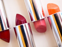 Lipstick colours. A still-life of some colorful lipstick stock photos