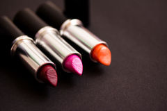 Lipstick colours, makeup essential. A still life of some lipsticks stock photo