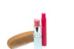 Lipstick and comb Stock Photo