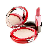 Lipstick and compact powder Royalty Free Stock Photography