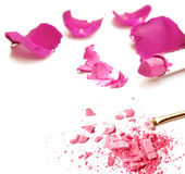 Lipstick, cosmetic powder and roses on white Stock Image