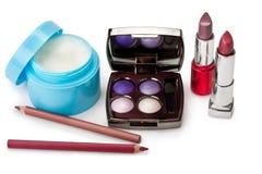 Lipstick, cream, eyeshadow Royalty Free Stock Images